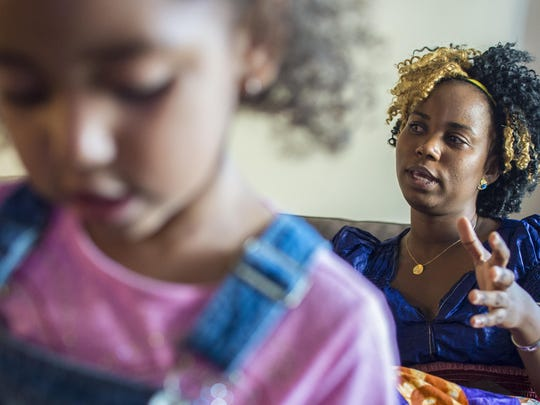 Alicia Araje, an immigrant from Burundi, speaks as her daughter Alison plays in their new Burlington apartment on Thursday, July 23. The pair endured hunger, instability and uncertainty as Araje navigated systems of social support.