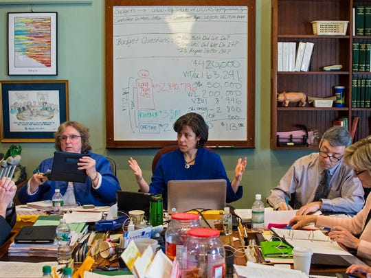 House Appropriations Committee chairwoman Rep. Mitzi Johnson, D-Grand Isle-Chittenden (center), works on the state budget with members of the committee at the Statehouse in Montpelier on Thursday.