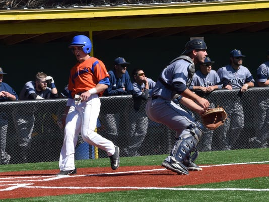 Louisiana College's Cody McNeal (15, left) reaches home ahead of Howard Payne's throw Saturday.