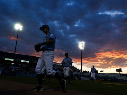 Dusk falls at Frawley Stadium as the Rocks tangle with the Frederick Keys, Friday, May 23, 2014.
