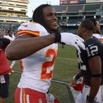 Kansas City Chiefs RB Jamaal Charles (25) is all smiles at the end of the game against the Oakland Raiders at O.co Coliseum. The Chiefs defeated the Raiders 56-31 on Sunday.