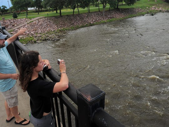Mitchell Joldersma looks at the Big Sioux River in Falls Park with Hattie Johnson, a landscape designer at RiverRestoration.org in Carbondale, Colo., while talking about the feasibility of a whitewater river bed on Tuesday.
