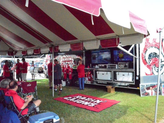 Tailgaters gather at Cajun Field in Lafayette before the game.