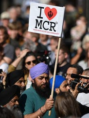"People from Manchester's Sikh community carry ""I ❤"