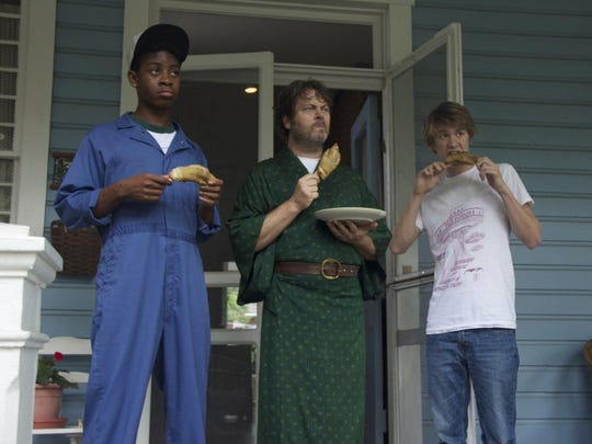 Nick Offerman, center, as Greg's dad, with RJ Cyler, left, as Earl and Thomas Mann as Greg.