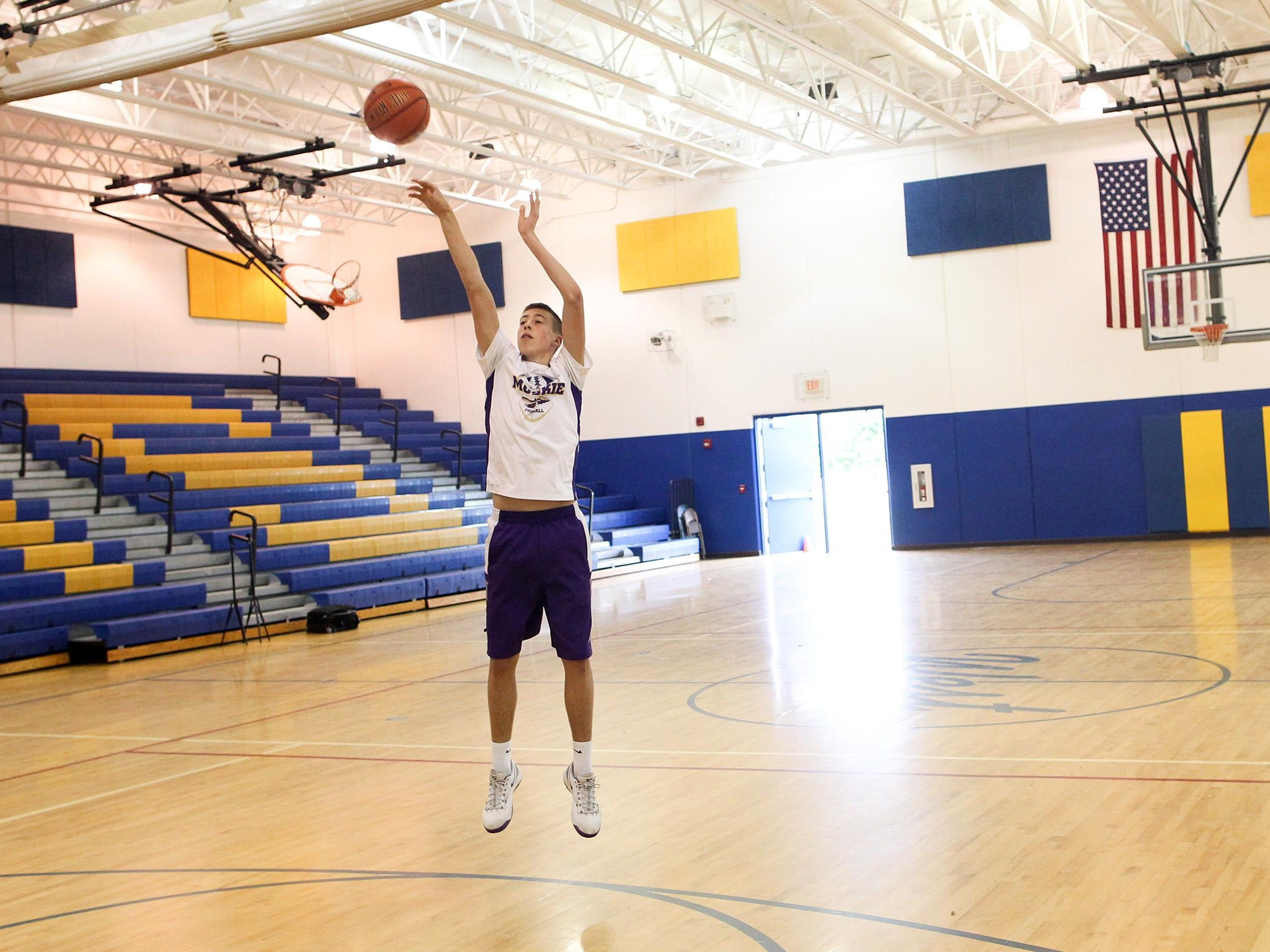Muscatine's Joe Wieskamp shoots around the West Middle School gym in Muscatine on July 2. The sophomore-to-be averaged 18.6 points and 6.1 rebounds as a freshman last season.