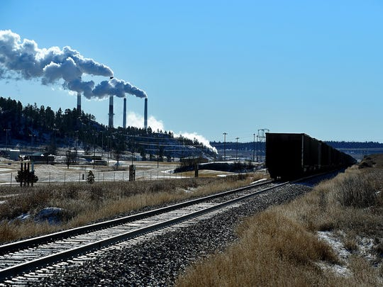 Empty coal cars sit along Montana Highway 39 in Colstrip. Montana could face energy challenges with the closure of Colstrip, a state energy panel was told by a representative of NorthWestern Energy.