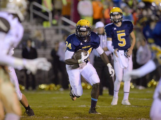 Grand Ledge running back Ba Blamo runs for a first down last Friday in a football game against Holt.