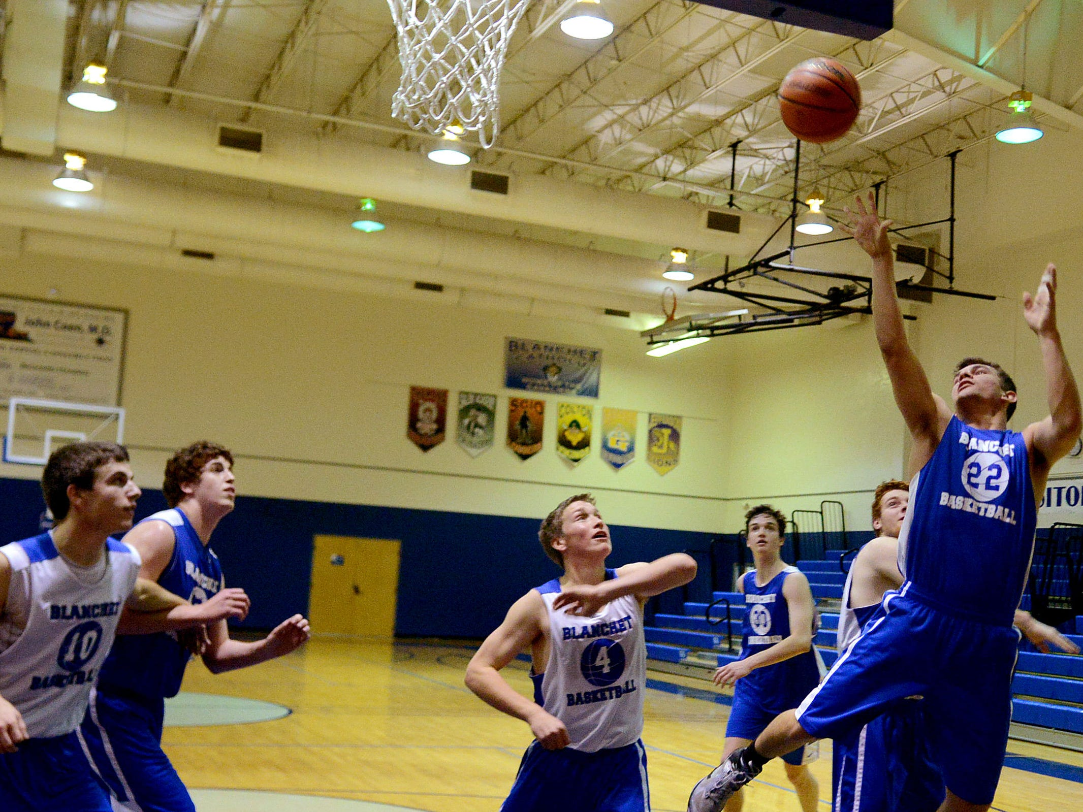 Players practice at Blanchet Catholic School in Salem on Thursday, Dec. 11, 2014. Scott Cantonwine, the new head coach, for the Blanchet Catholic boy's basketball team, is returning to high school coaching after nearly 20 years.