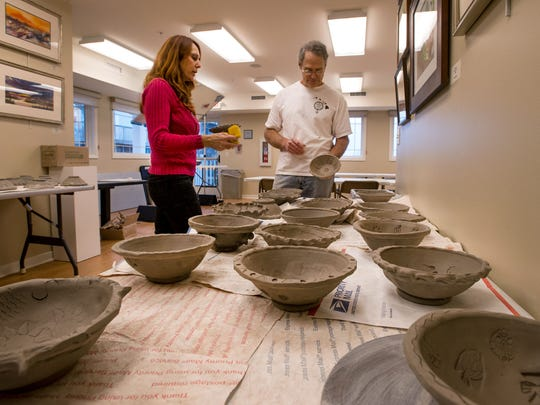 Ocean City Art League Ceramics Directors Nancy Barnas and Erik Hertz look over bowls that were completed Saturday afternoon at the 94th Street facility.