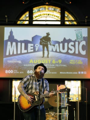 Christopher Gold performs during the Mile of Music kickoff announcement. The four-day music festival returns for its third year Aug. 6-9.