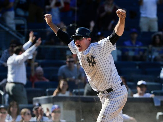 June 30: Yankees' Chase Headley celebrates after scoring