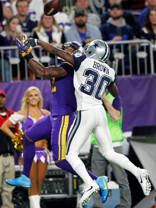 Dallas Cowboys cornerback Anthony Brown, right, breaks up a pass intended for Minnesota Vikings wide receiver Charles Johnson during the second half of an NFL football game Thursday, Dec. 1, 2016, in Minneapolis. (AP Photo/Andy Clayton-King)