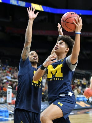 Michigan's Charles Matthews, left, and Jordan Poole are listed among Sports Illustrated's top 60 2019 NBA Draft prospects.