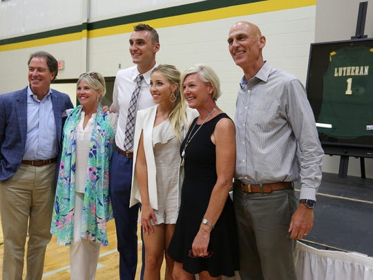 From left: Kevin Harlan, his wife Ann, Sam Dekker,
