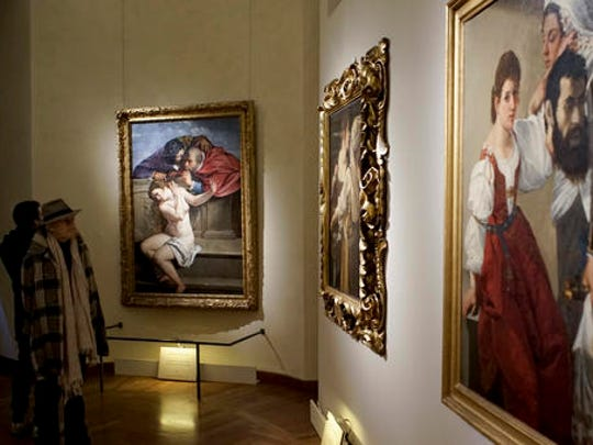 "Visitors admire paintings, from left,  ""Susanna and the Elders"", Judith and her Maidservant Abra"" and ""Judith with the Head of Holofernes"" by Italian 17th century artist Artemisia Gentileschi, on display at Rome's Braschi Palace museum, Tuesday, Nov. 29, 2016.  The Braschi museum is hosting the 'Artemisia Gentileschi and her Times' exhibition from Nov. 30, 2016 to May 7, 2017."