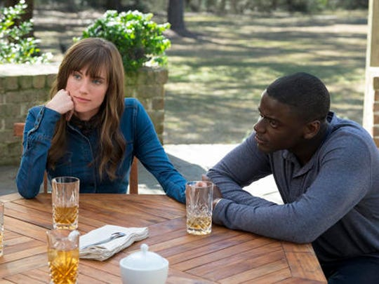"""This image released by Universal Pictures shows Allison Williams, left, and Daniel Kaluuya in a scene from, """"Get Out."""""""