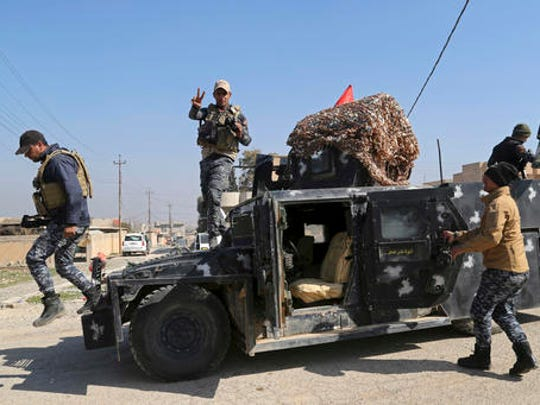 Iraqi Federal police deploy after regaining control of the town of Abu Saif, west of Mosul, Iraq, Wednesday, Feb. 22, 2017. Iraq's government-sanctioned paramilitary forces, made up mainly of Shiite militiamen, have launched a new push to capture villages west of the city of Mosul from Islamic State militants.