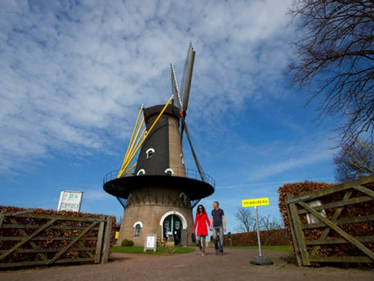 A couple of voters leaves the Kerkhovense Molen, a