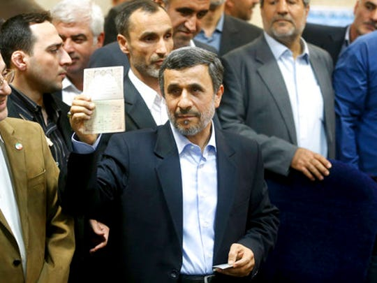 Former Iranian President Mahmoud Ahmadinejad shows his identification during registering his candidacy for the upcoming presidential elections at the Interior Ministry in Tehran, Iran, Wednesday, April 12, 2017. Ahmadinejad on Wednesday unexpectedly filed to run in the country's May presidential election, contradicting a recommendation from the supreme leader to stay out of the race.