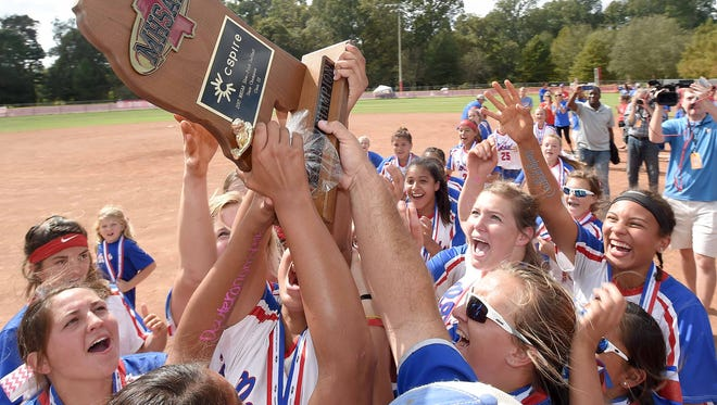 The Neshoba Central Lady Rockets celebrate with the Class III trophy after beating Wayne County in two straight games on Saturday in Ridgeland.