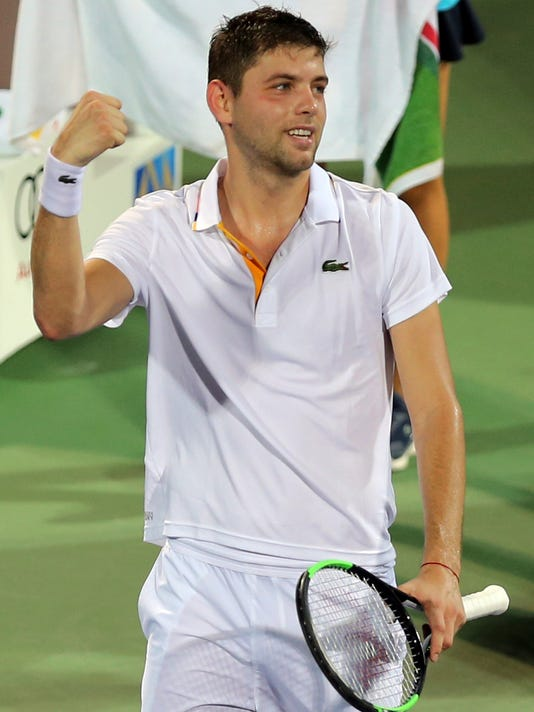 Filip Krajinovic of Serbia celebrates after he beats Evgeny Donskoy of Russia during the Dubai Duty Free Tennis Championship in Dubai, United Arab Emirates, Thursday, March 1, 2018. (AP Photo/Kamran Jebreili)