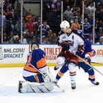 Columbus Blue Jackets center Brandon Dubinsky (17) watches the puck shot by left wing Scott Hartnell get past New York Islanders goalie Jaroslav Halak (41) for a goal to tie the score during the third period of an NHL hockey game Saturday, April 11, 2015, in Uniondale, N.Y. The Blue Jackets won 5-4 in a shootout.