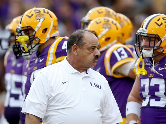 Then-LSU Tigers defensive coordinator John Chavis walks on the sideline before a 2014 game against New Mexico State.