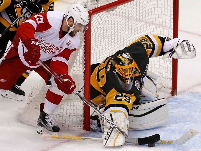 Pittsburgh Penguins goalie Marc-Andre Fleury blocks