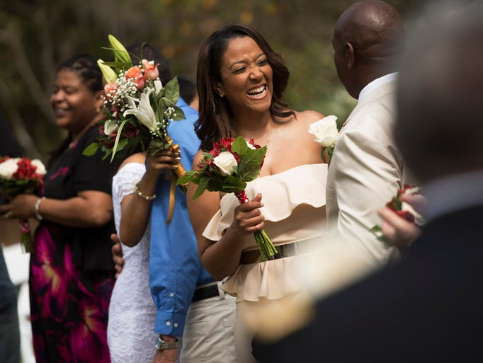 Kimberly Jones (center) reacts after being wed to her