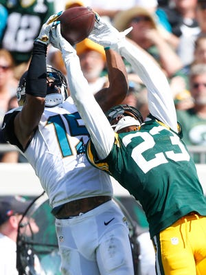 Green Bay Packers cornerback Damarious Randall (23) defends Jacksonville Jaguars wide receiver Allen Robinson (15) in the fourth quarter at EverBank Field.