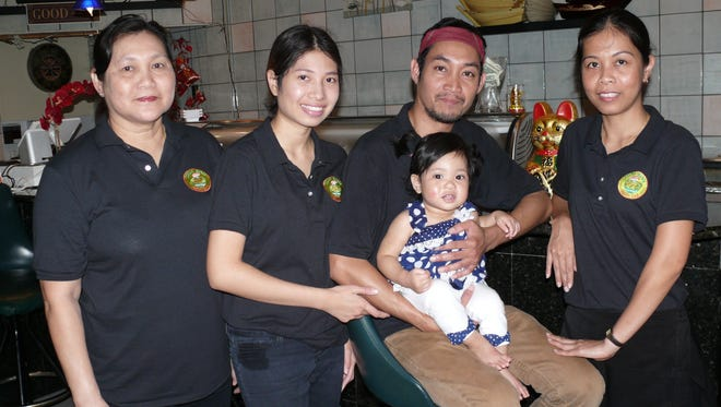 "Thai Koji Chef Anurak ""Bas"" Trisophon poses with the women in his life: (from left) his mother Mam, wife Pearry, baby Bella and sister Ann."