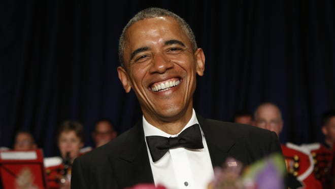 Present Obama laughs at the 2015 White House Correspondents' Association Dinner on April 25.