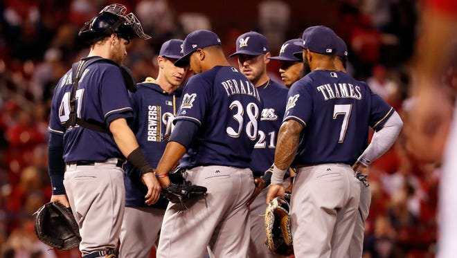 Brewers starting pitcher Wily Peralta is removed from the game in the sixth inning.