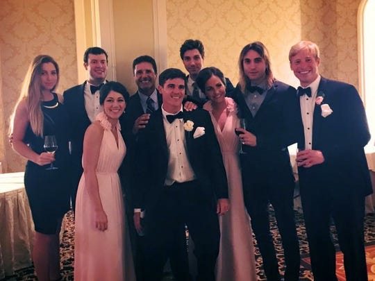 Some of Acuna's former players reunited at Chris Martin's (first row, center) wedding.