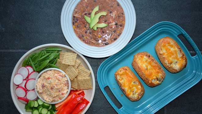 Pimiento cheese with crudites and crackers, Slow Cooker Chicken Taco Chili and Creamy Mushroom-Stuffed Garlic Bread are super game day fare.