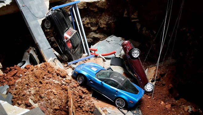 This Feb. 12, 2014 file photo shows a view of a sinkhole that opened up in the Skydome showroom at the National Corvette Museum in Bowling Green, Ky., and swallowed eight display cars.