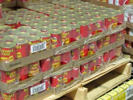 Cans of chili await distribution at the Food Bank of