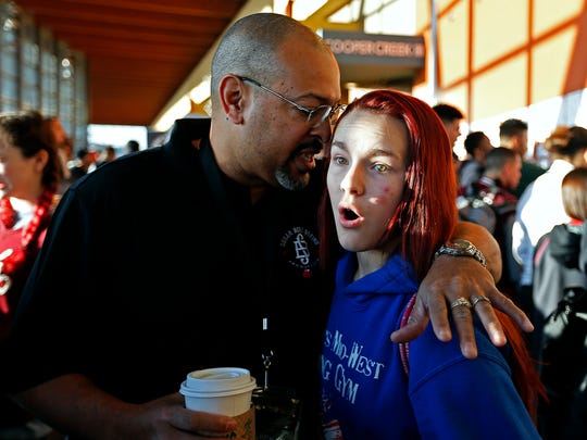 Shilyn Bradt reacts as her coach, Darrell Smith, tells