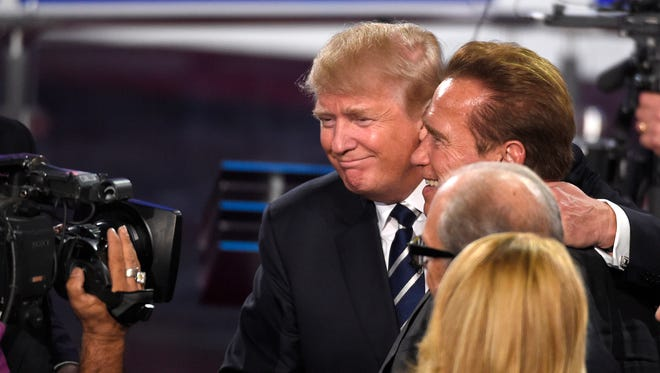 'Apprentice' hosts past and future, Republican presidential candidate  Donald Trump and former California Gov. Arnold Schwarzenegger, seen after a CNN Republican presidential debate.