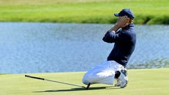 Jordan Spieth of the United States reacts to missing