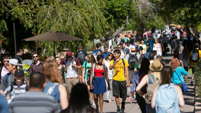 10/8/2013 -- 1008131200ar pni1010-met athletic fees -- Students walk between classes at the ASU Tempe campus on Tuesday, October 8, 2013. Michael Schennum / The Arizona Republic