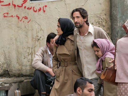 "Salma Hayek and Adrien Brody in ""Septembers of Shiraz."""