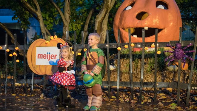 "Kinley Gentry, 2, and her brother Carter Gentry, 4 are photographed in front of Mumpkin the Giant Talking Pumpkin at ""The World's Largest Halloween Party"" at the Louisville Zoo. Oct. 24, 2015"