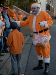 Vol Santa hands out candy canes before the game between Vanderbilt and Tennessee at Vanderbilt Stadium on Saturday, Nov. 26, 2016, in Nashville, Tenn.