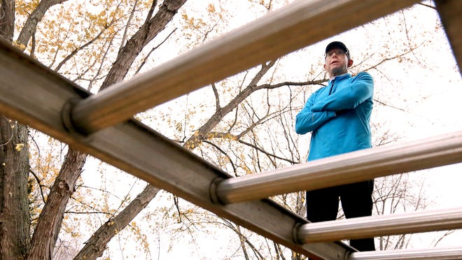 This Thursday, Nov. 13, 2014 photo shows an aluminum ladder suspended horizontally outside the Fond du Lac, Wis., home of mountain climber Andy Land which serves as training apparatus designed to mimic equipment he will use to traverse treacherous ice falls during an upcoming attempt to reach the summit of Mt. Everest in the spring of 2015. The experienced climber is in the midst of a strict, twice a day, seven-days-a-week training regimen in advance of the venture. Land, a hospice nurse for nearly 15 years, has raised $75,000 but would like to hit $1 million in his Climbing for Hospice campaign for the Hospice Organization & Palliative Experts (HOPE) of Wisconsin, a membership organization for all hospice and palliative care programs in the state.