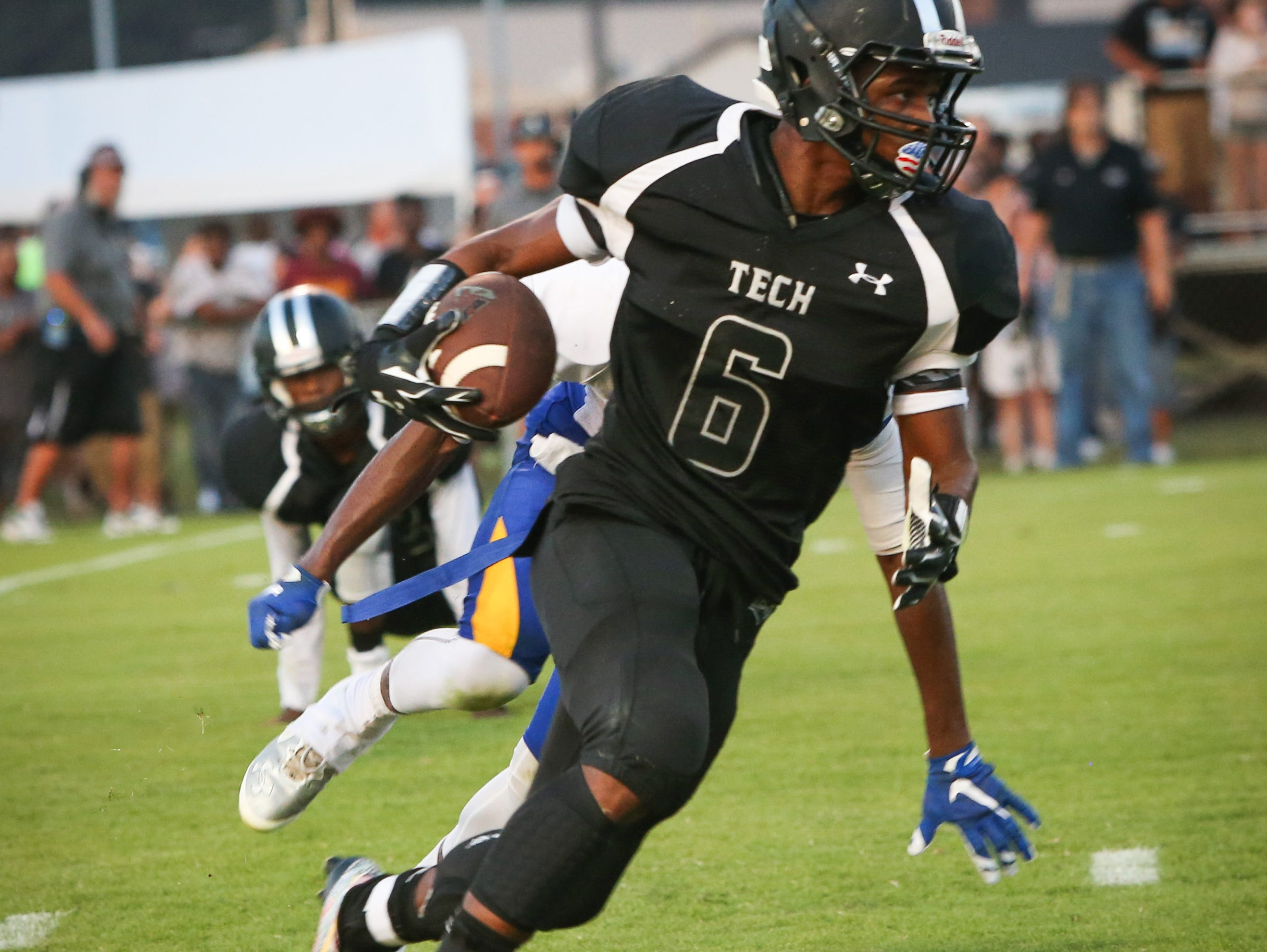 Sussex Tech senior running back Isaiah Brown runs the ball during the first quarter of the DFRC Kickoff Classic at Sussex Tech Thursday. Brown had six touchdown's in the first half.