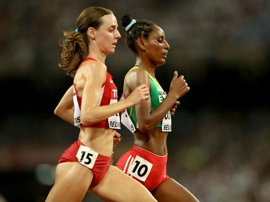 Molly Huddle, left, Belaynesh Oljira of Ethiopia compete in the women's 10,000 meters Monday at the IAAF World Championships at Beijing National Stadium.