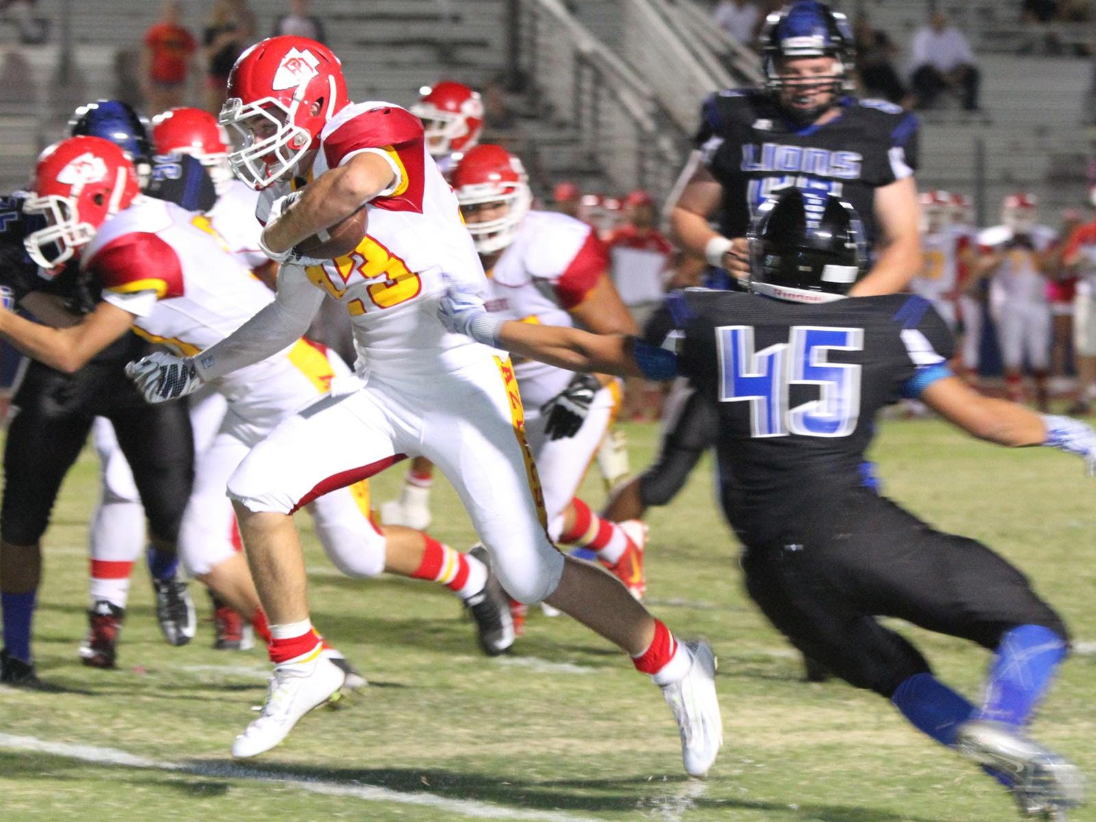 10/16/15 Taya Gray, Special to The Desert Sun Palm Desert's Beau Berryhill runs the ball during the first half of the game in Cathedral City on Friday, October 16, 2015.