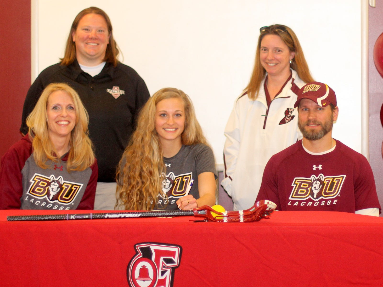 Elmira High School senior Jordynn Kurcoba signs a ceremonial letter of intent to play lacrosse at Bloomsburg University. Seated next to her are her parents, Bryan and Christine Kurcoba. In the background, from left, are current Elmira girls lacrosse head coach Tammy Woodard and former Express head coach Jana Reidy.
